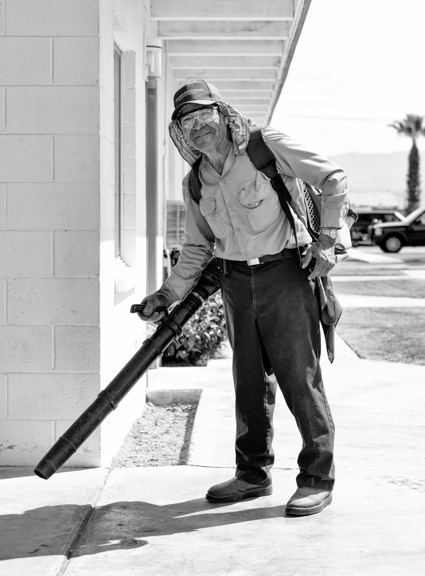 Gardener operating a leaf blower in Indio, CA.