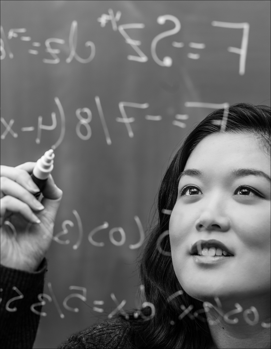 An Asian American student solving mathematical equations.