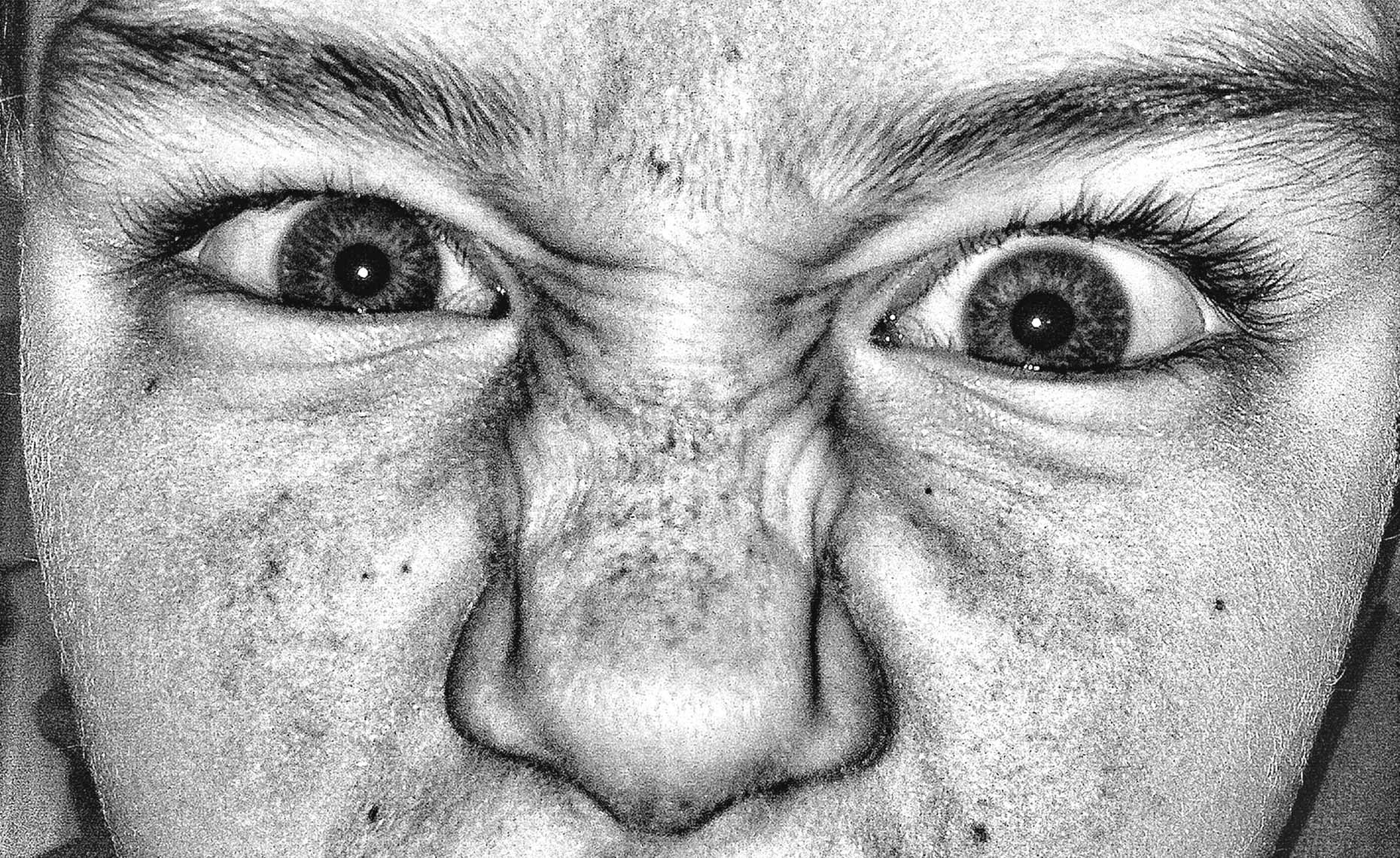 Extreme black and white close up of a boy